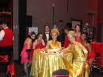 Moulin Rouge performers with gold table dress ladies