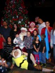 Charlie Brown, Lucy & Linus with Santa & guests in front of a Christmas Tree