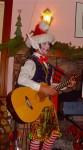 Christmas with Santa's helper -Elf playing guitar-