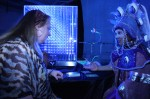 Illuminated fortune teller reading tarot cards to guest next to the magical light box & dragonflies