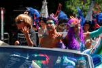 Aqua Convertible pulling San Francisco Showgirls on roller skates