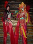 Red phoenix and devilette on stilts
