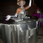 Platinum lady reads tarot from her table skirt