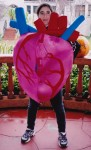 The kids learn human biology through rap music and hip-hop dance characters in human organ costumes. Shown: heart, brain, lungs.