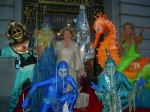 Under water fantasy ensemble of characters swim, float, fly, skate, glide, dance, and parade