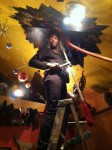 Installing new circus zodiac painting in the Earth Room above the trapeze at Gregangelo's Velocity Headquarters