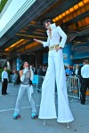 Elvis on stilts with his hysterical fan