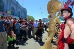 Crowd gathering around Gilded Gaultier & Mr. Virile Vasc at San Francisco Pride Parade