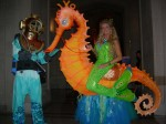 Under water fantasy ensemble of characters swim, float, fly, skate, glide, dance and parade