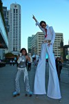Elvis Presley on stilts with his hysterical fan on roller skates