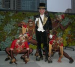 Ringmaster Roller Skater and Monkeys